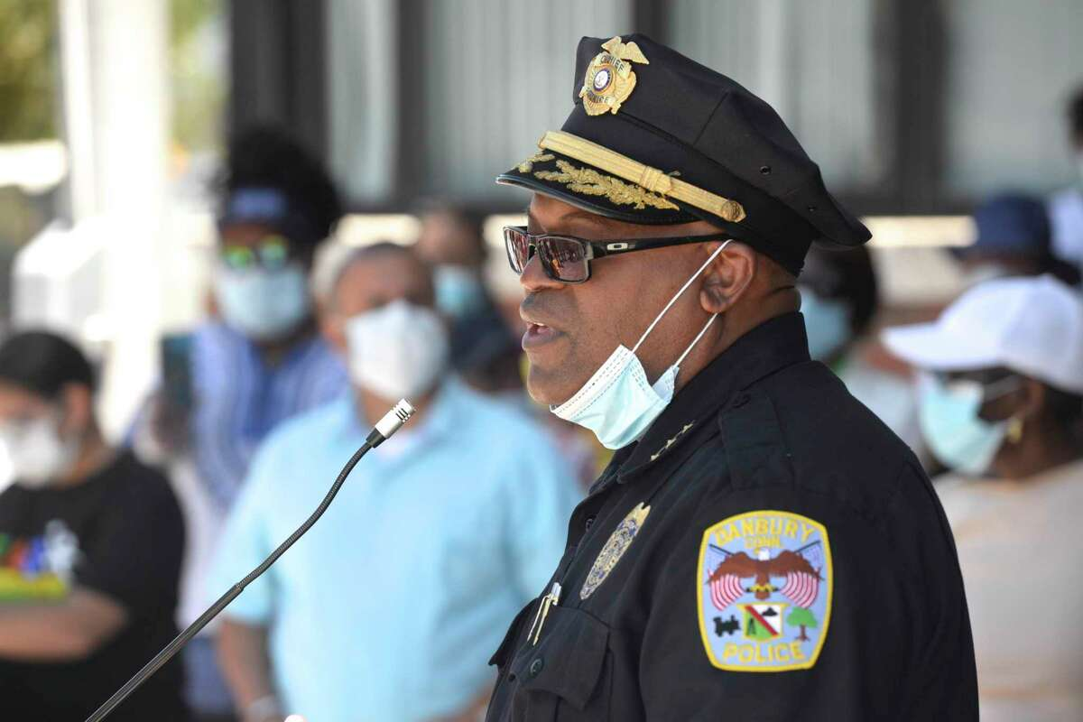 Police Chief Patrick Ridenhour speaks to those gatherd after a prayer walk in protest of racial injustice in front of City Hall mid-day, Thursday, June 25, 2020, in Danbury, Conn.