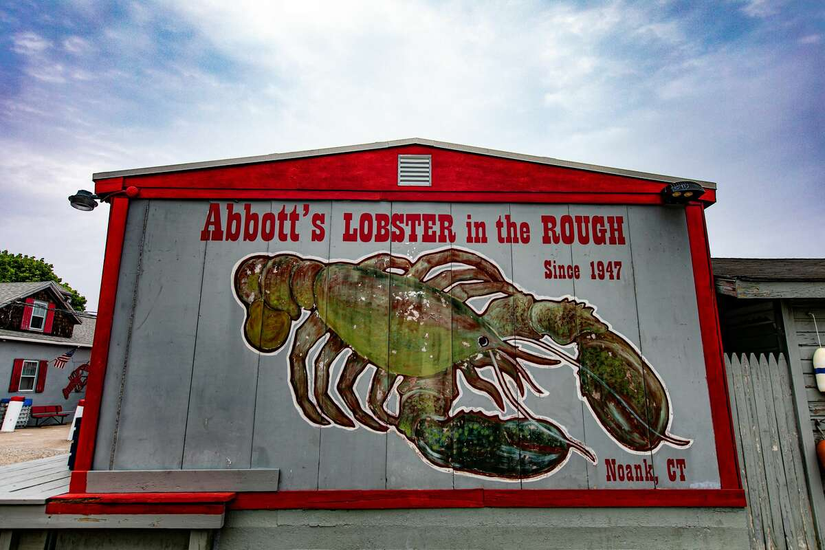 A giant lobster mural greets customers at Abbott's Lobster in the Rough in Noank, Conn. on June 4, 2021.