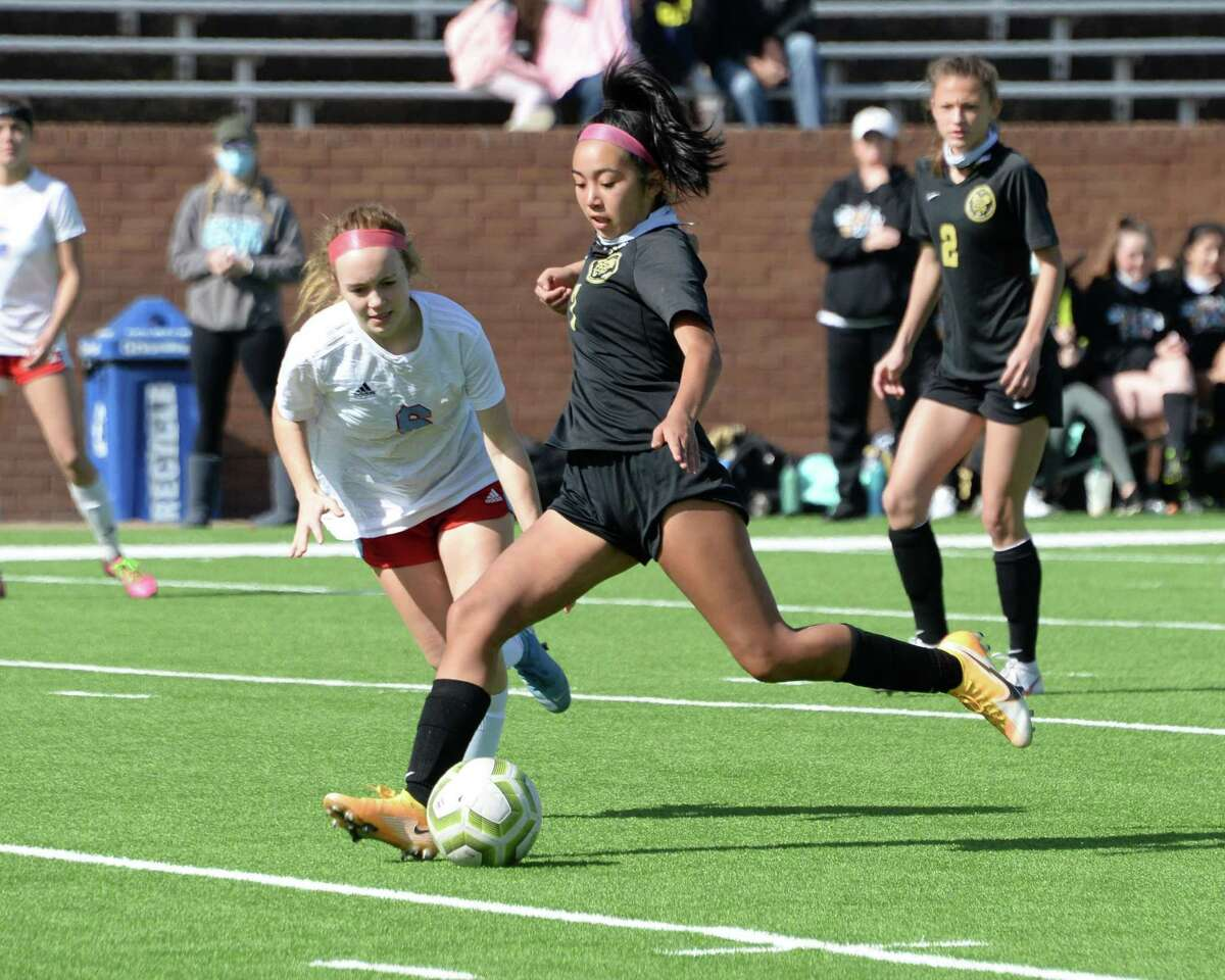 Abrianna Morales (7) of Foster takes a shot on goal during the second half of the Maverick Bracket Championship game of the I-10 Shootout between the Foster Falcons and the Lumberton Raiders on Saturday, January 16, 2021 at Rhodes Stadium, Katy, TX.