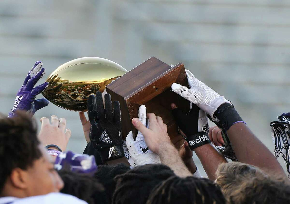 Fort Bend Ridge Point varsity football team holds up their trophy after defeating Humble Atascocita 55-45- at TDECU Stadium in Houston on Saturday, Dec. 26, 2020.