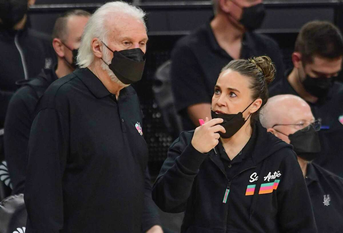 San Antonio Spurs head coach Gregg Popovich and assistant Becky Hammon converse during second-half NBA action in the AT&T Center on Monday, March 1, 2021.