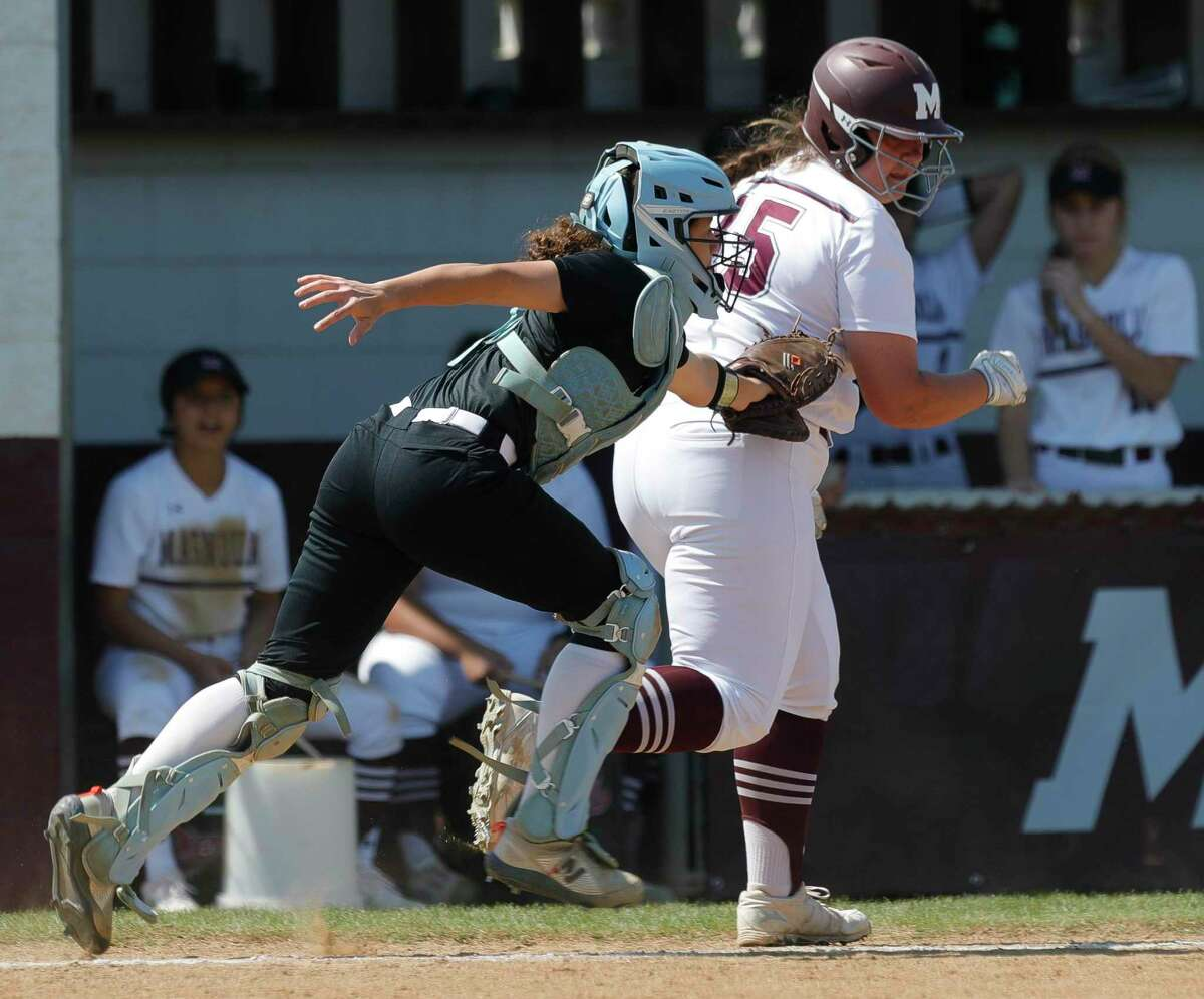 Katy Paetow catcher Samantha Guillory tags out Tori Vieth #15 of Magnolia in rundown during the fourth inning of a District 19-5A high school softball game at Magnolia High School, Saturday, March 20, 2021, in Magnolia.