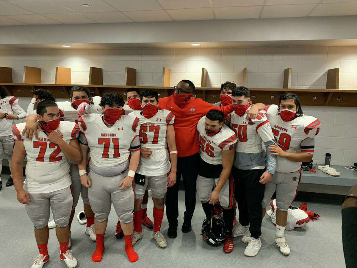 Terry football coach Darnell Jackson poses with members of the Rangers' offensive line during the 2020 season. Jackson was promoted from offensive coordinator to head coach in June.