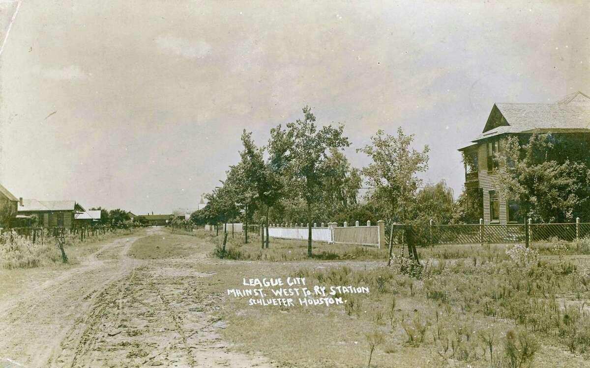 A postcard image using a photo taken by Houston photographer F.J. Schlueter shows League City's Main Street (now Second Street) in a view westward toward the railroad station. The Helen Hall Library's History Club covers hometown topics plus ones related to Texas and national themes.