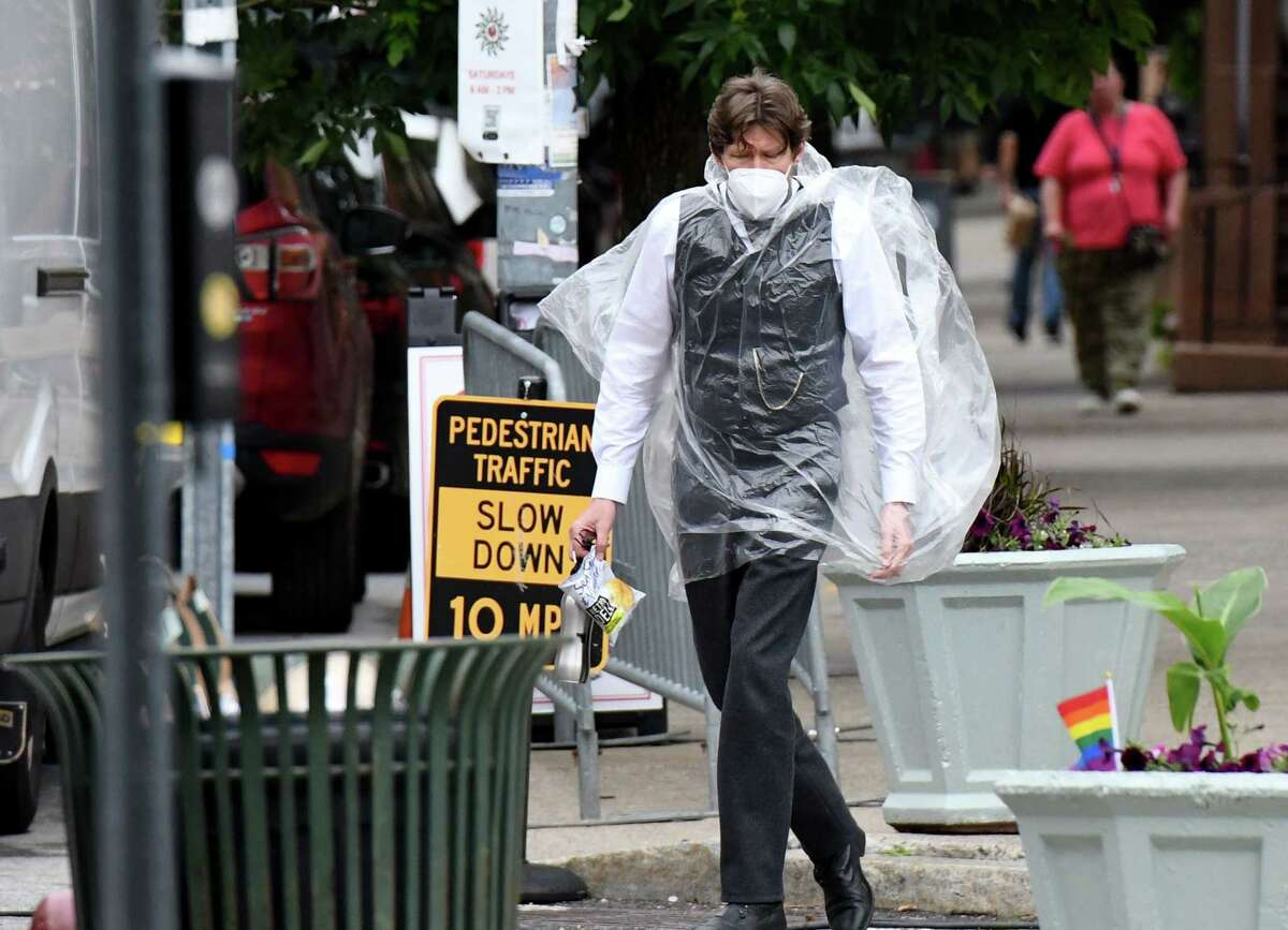 An actor in the HBO series 'The Gilded Age' walk to the Second Street film set on Monday, June 14, 2021, as crews head into the final days of downtown production in Troy, N.Y. (Will Waldron/Times Union)