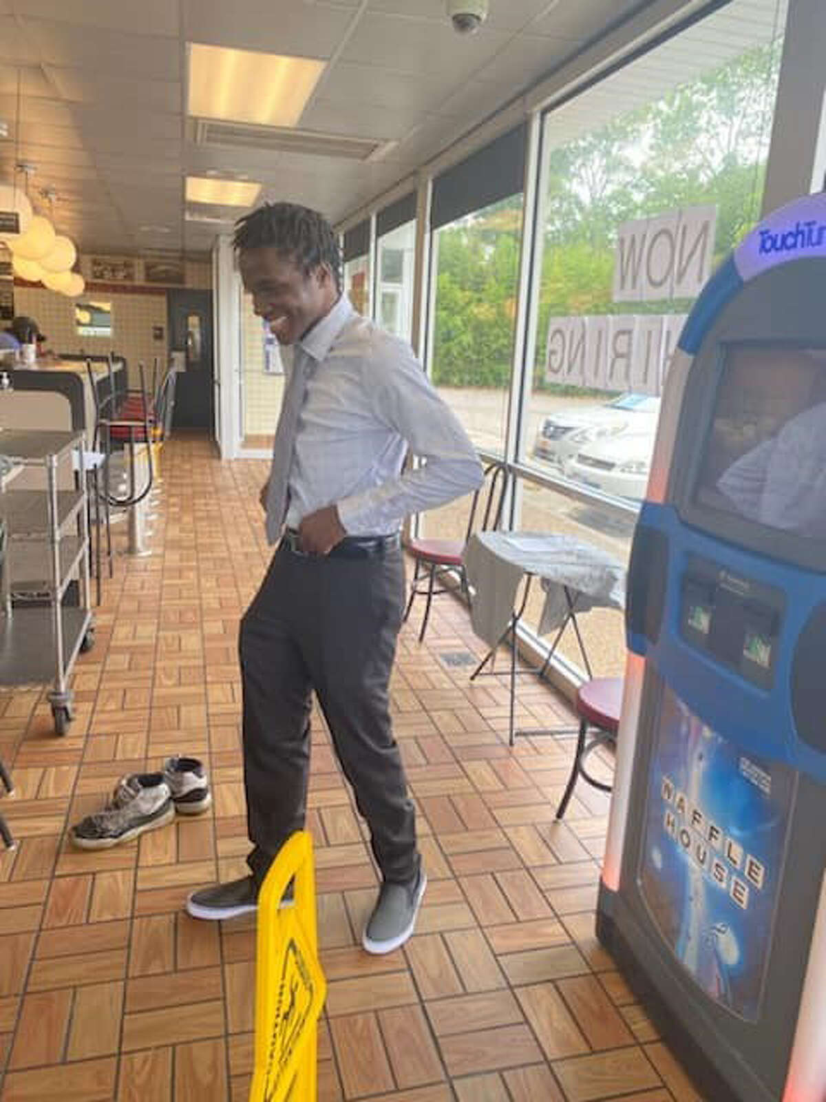 Several Waffle House staff members and customers pitched in to buy Harrison a new outfit from Target for graduation day.