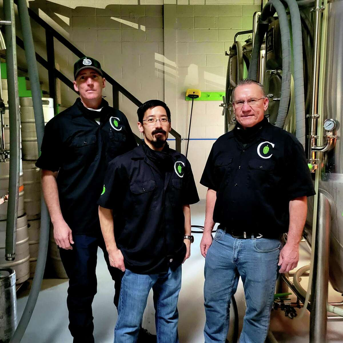 From left are Drew France, Brian Aida and Dave Peichert, co-owners of Concentric Brewing Company at 91 Main St. in Portland.