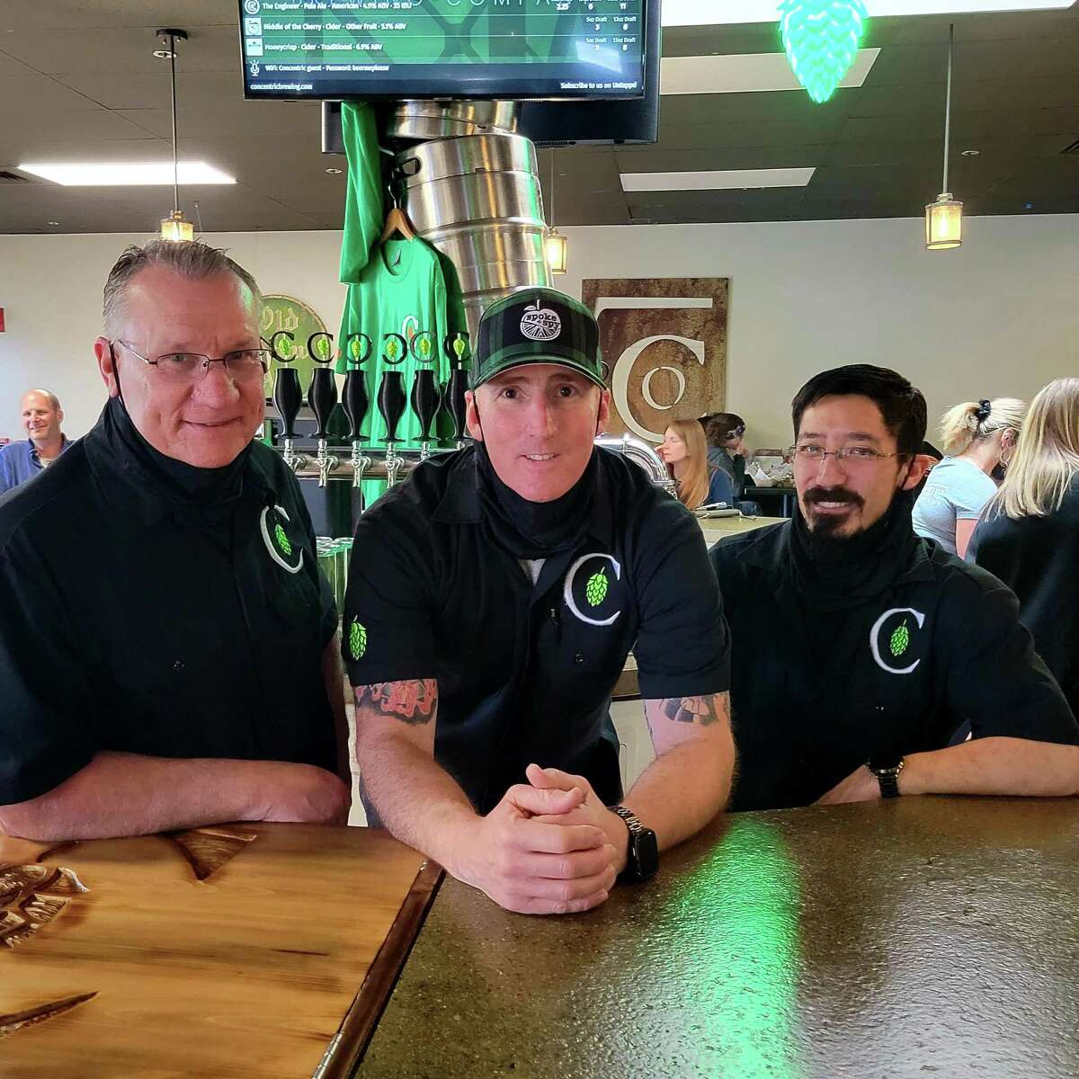 From left, Dave Peichert, Drew France and Brian Aida pose for a photo at Concentric Brewing Company in Portland, which they all own.