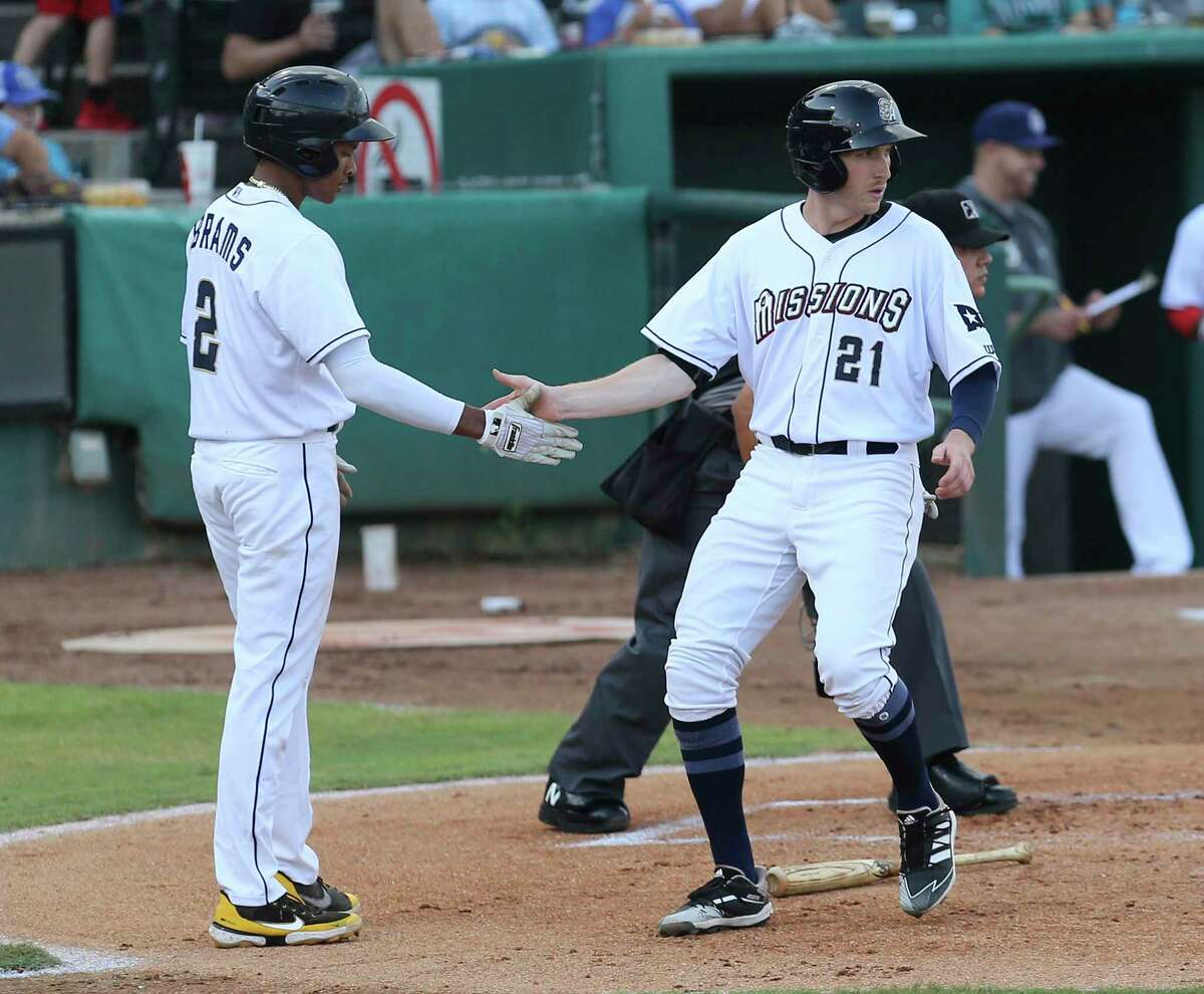 Missions' C.J. Abrams (left) and Taylor Kohlwey (21) scores the team's first two runs in the first inning against the Midland RockHounds at Wolff Stadium on Tuesday, June 8, 2021. The facility was opened to full capacity seating for the first time since the pandemic.