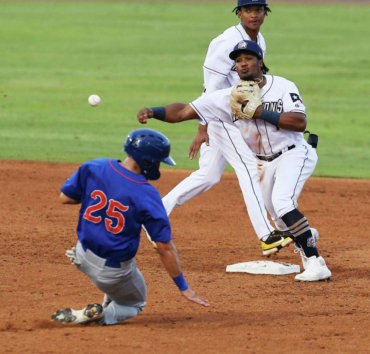 Missions' Eguy Rosario (1) forces the out at second on Midland's Chase Calabuig (25) and turns a double at first in the third inning against the RockHounds at Wolff Stadium on Tuesday, June 8, 2021.