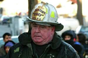 In 2003, then New Haven Assistant Fire Chief Michael Grant at a Plymouth Street fire. Grant died in June 2021.