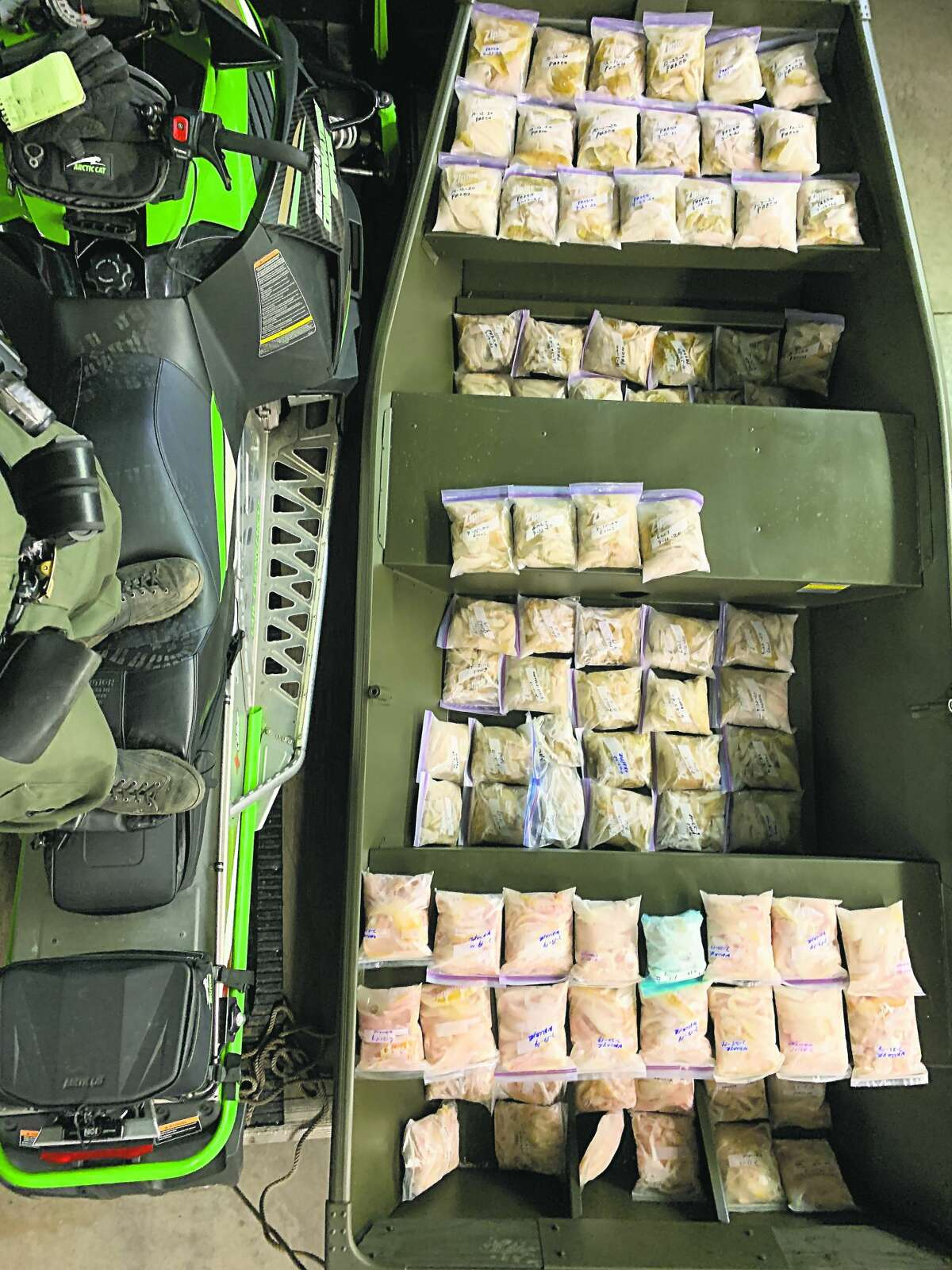 A DNR officer and a Huron County sheriff's deputy reportedly uncovered this unlawful amount of stored fish at the residence of a Caseville man, who is one of two facing charges of overfishing.