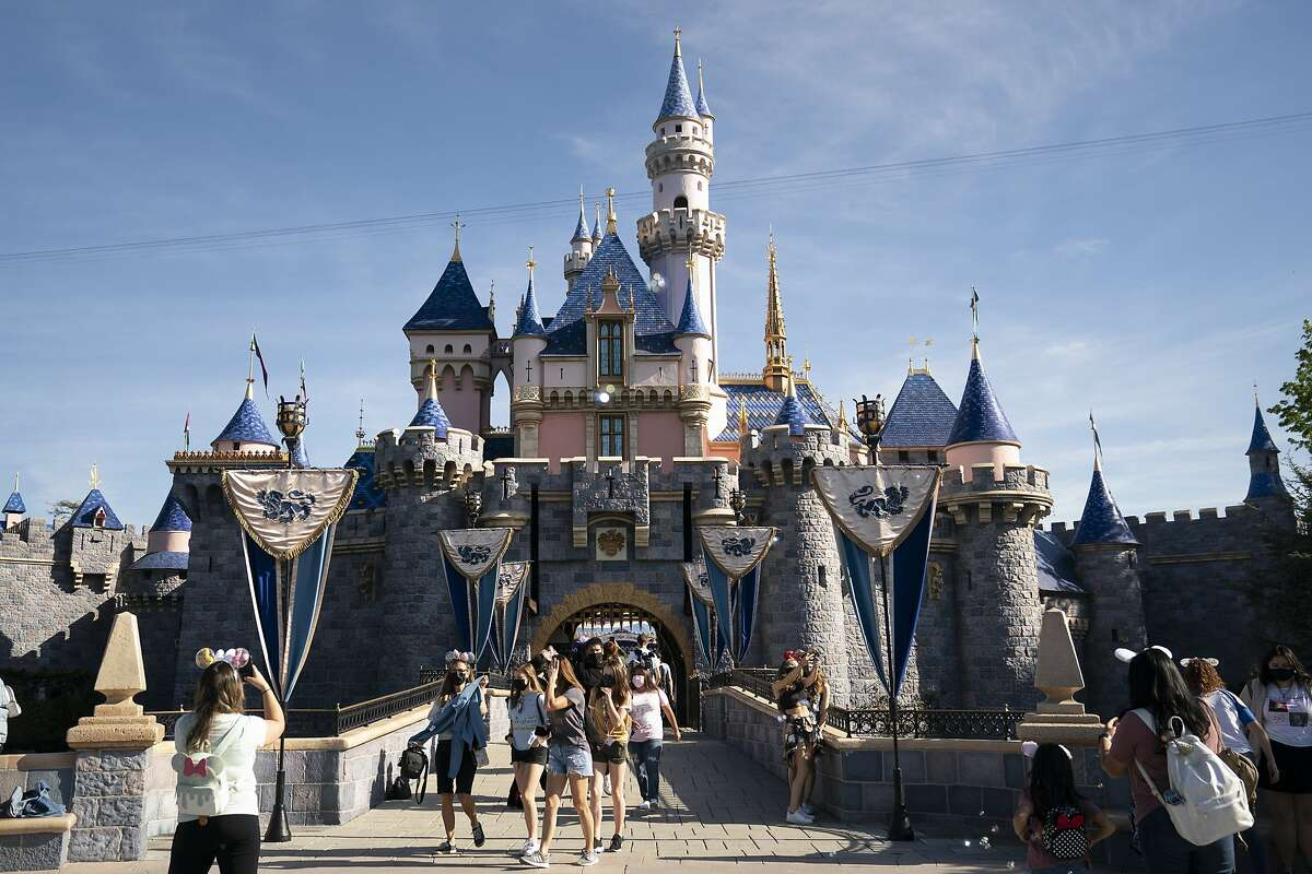 Visitors exit the Sleeping Beauty Castle at Disneyland in Anaheim, Calif., on April 30, 2021.