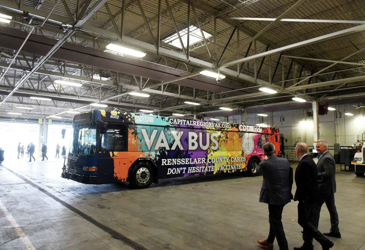 Capital District Transportation Authority CEO Carm Basile, left, takes Albany Medical Center President and CEO Dr. Dennis McKenna, center, and Rensselaer County Executive Steve McLaughlin, right, to see the new CDTA Vax Bus on Monday, June 14, 2021, during an announcement at CDTA headquarters in Albany, N.Y. The Vax Bus is a partnership between Rensselaer County and CDTA to promote and administer vaccinations in Rensselaer County. (Will Waldron/Times Union)