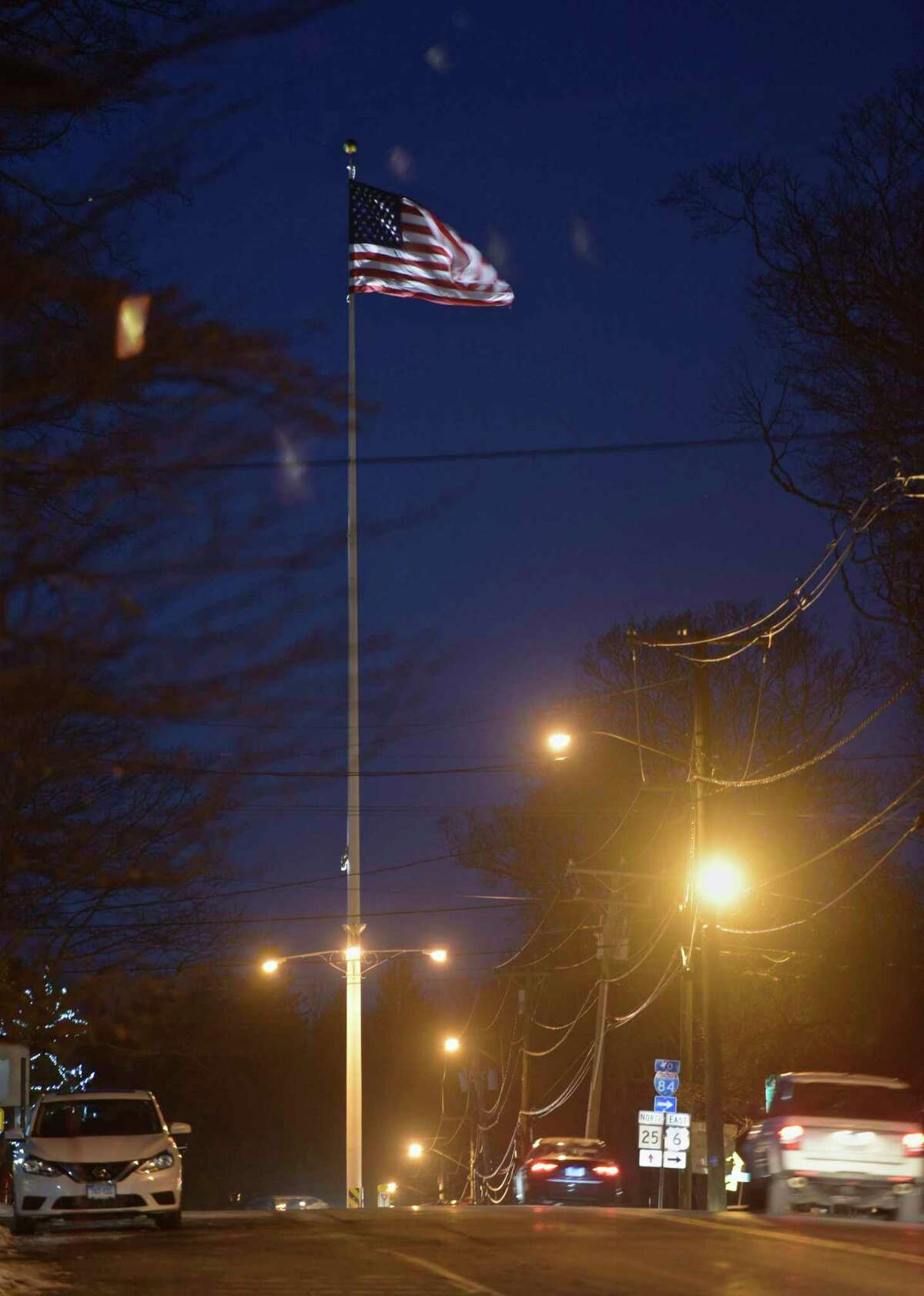 Newtown flagpole, Route 25, Newtown, Conn, on Wednesday night, December 13, 2017,