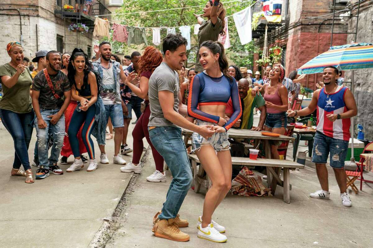"""Anthony Ramos, left, and Melissa Barrera in Jon M. Chu's """"In the Heights,"""" based on Lin-Manuel Miranda's hit Broadway musical. (Macall Polay/Warner Bros/TNS)"""
