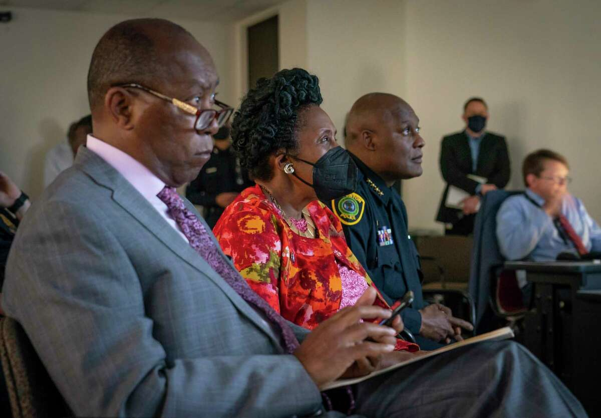 Houston Mayor Sylvester Turner, Congresswoman Sheila Jackson Lee and Houston Police Department Chief Troy Finner watch video during a press conference releasing body-worn camera footage of a May 21st officer-involved shooting at a traffic stop, Thursday, June 3, 2021, inside a conference room in HPD's downtown office in Houston.