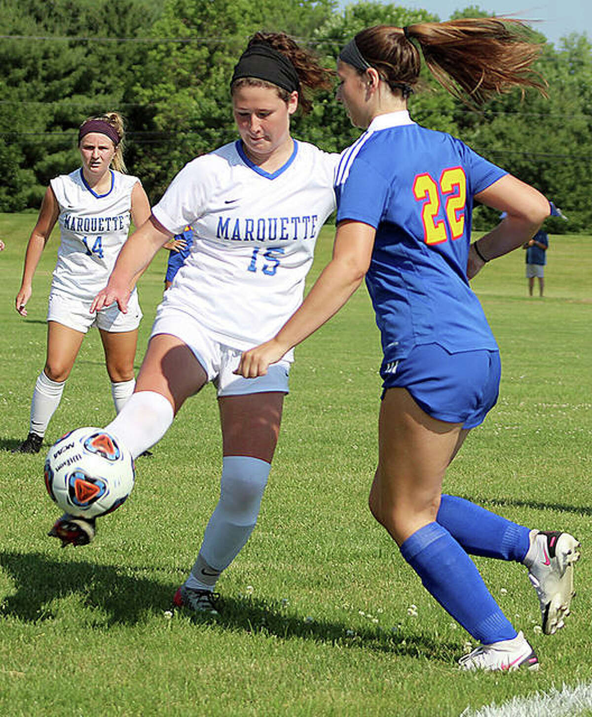 Madelyn Smith of Marquette (15) controls the ball in last week's sectional championship game.