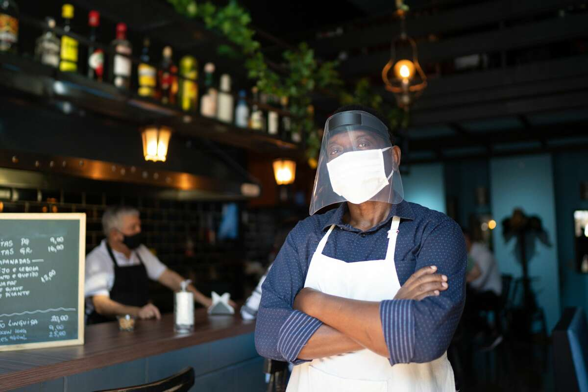 On June 15, fully vaccinated people will no longer be required to wear masks in most situations. Here's how grocery store workers and restaurant workers are feeling about the reopening.