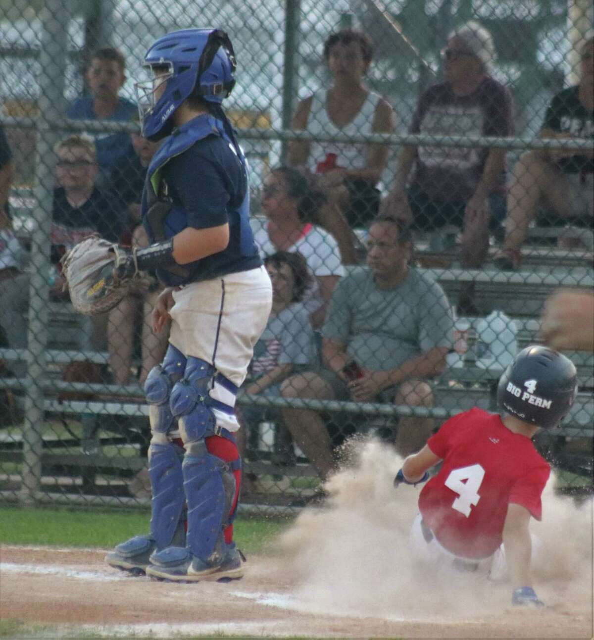 Bayside's Kross Kilgo slides in with the only run the team would need Sunday night after three pitchers finished with a four-hitter.