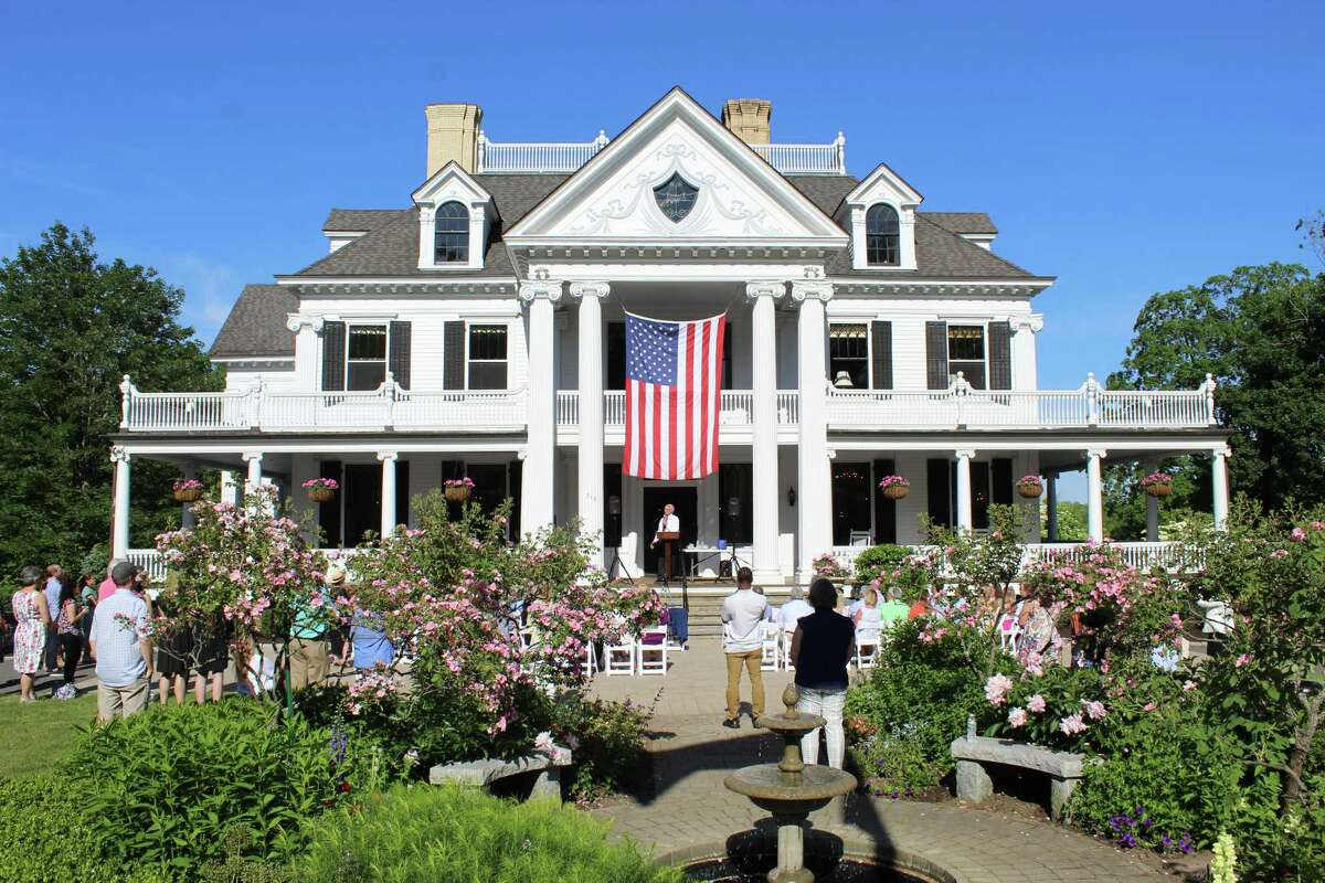 Residents gathered outside Lounsbury House on Thursday afternoon to hear First Selectman Rudy Marconi's remarks during the State of the Town address.