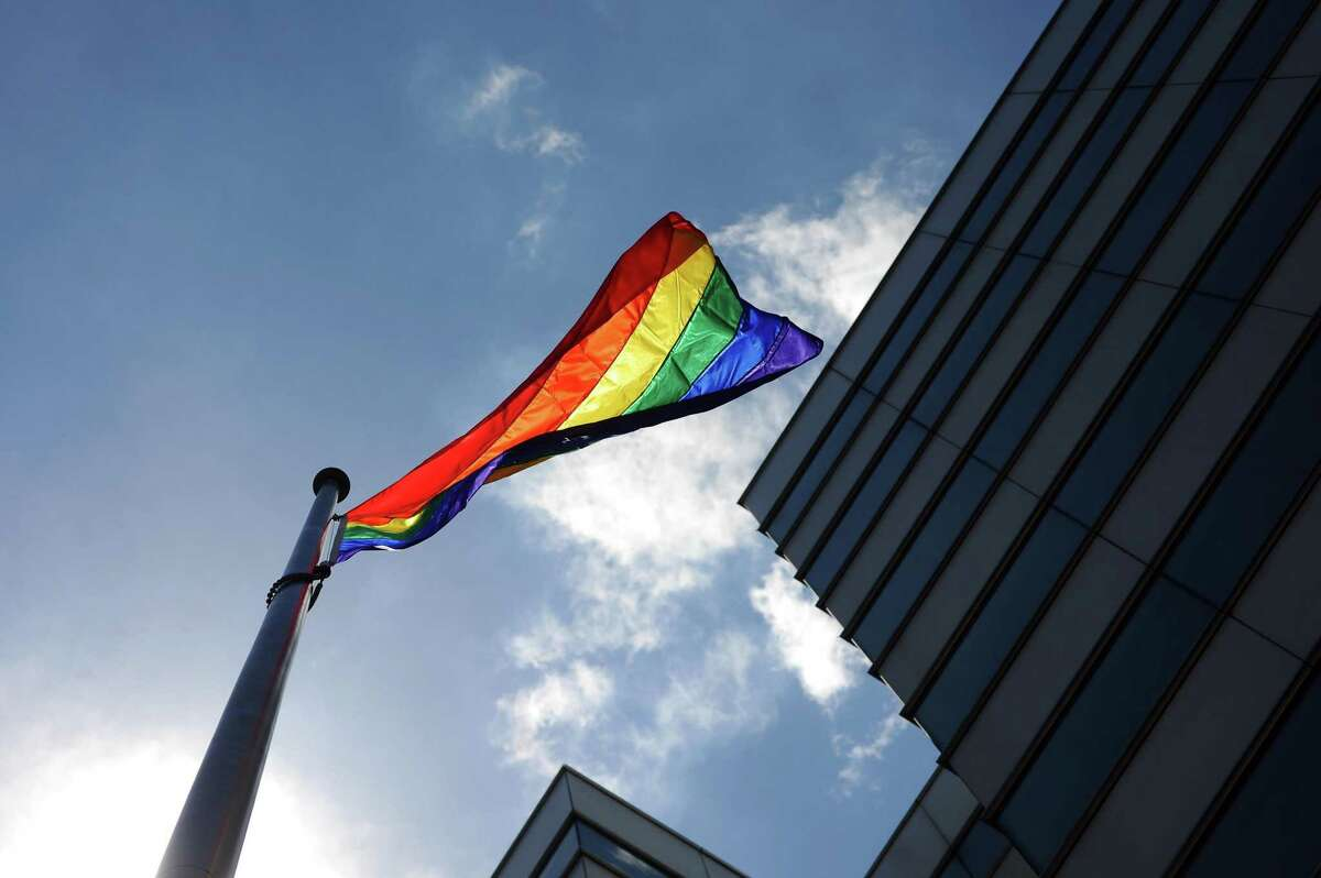 The city of Stamford raises the LGBT Pride Flag to commemorate the one-year anniversary of the Pulse nightclub attack and to honor Pride Month outside of Government Center in downtown Stamford, Conn. on Wednesday, June 14, 2017.