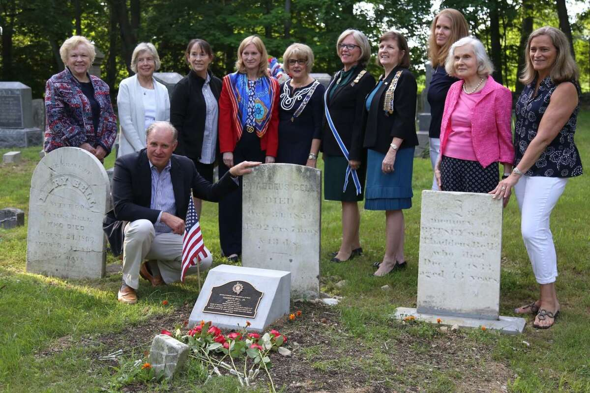 Scott Sherwood, a direct descendant, poses with members of the Daughters of the American Revolution by the grave of Thaddeus Bell, Jr.
