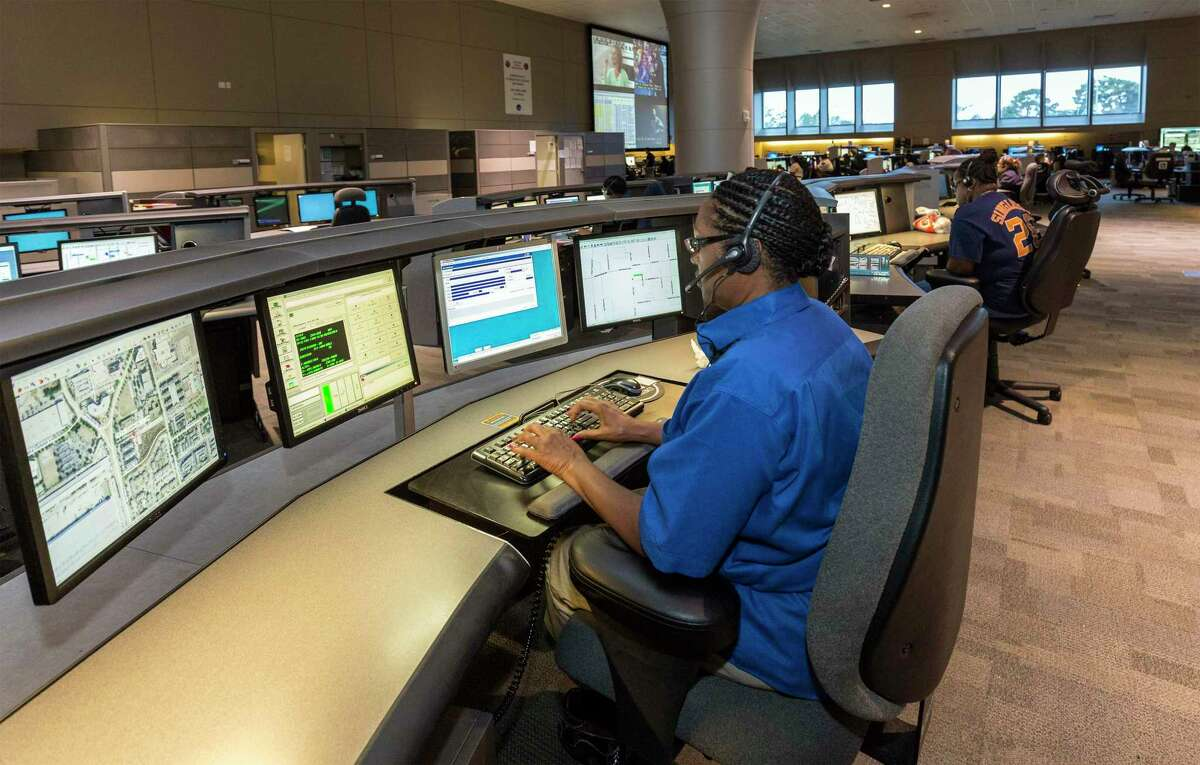 In this file photo from 2014, a dispatcher takes a call at the Houston Emergency Center.
