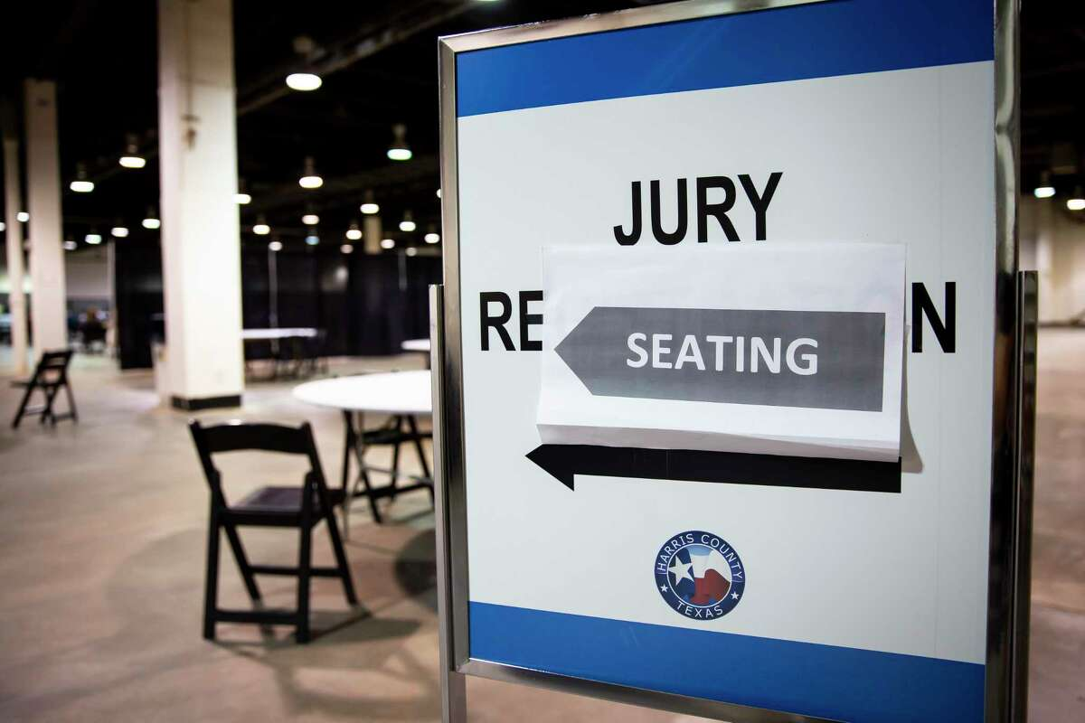 A sign directs visitors to the jury seating area in the NRG Arena in the NRG Park on Monday, June 14, 2021.