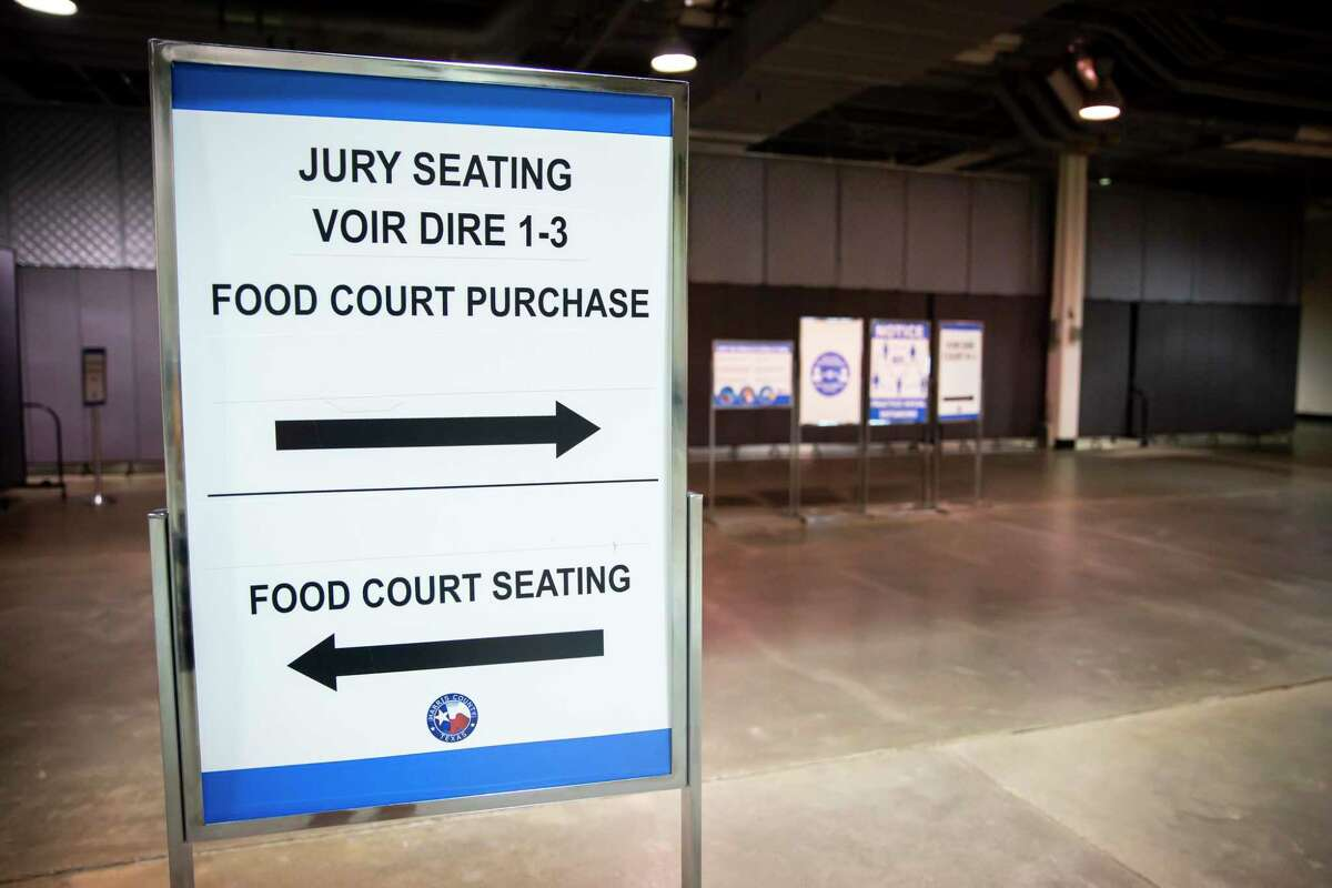 Signs help jurors find their assignments in the NRG Arena in the NRG Park on Monday, June 14, 2021.