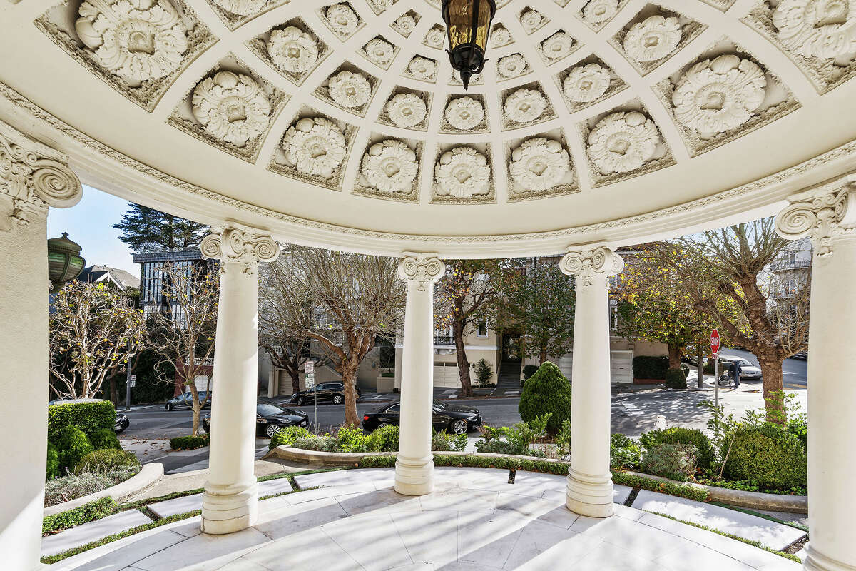 Looking back toward Pacific Avenue with the portico overhead, there's intricate lace-like carving in the marble.