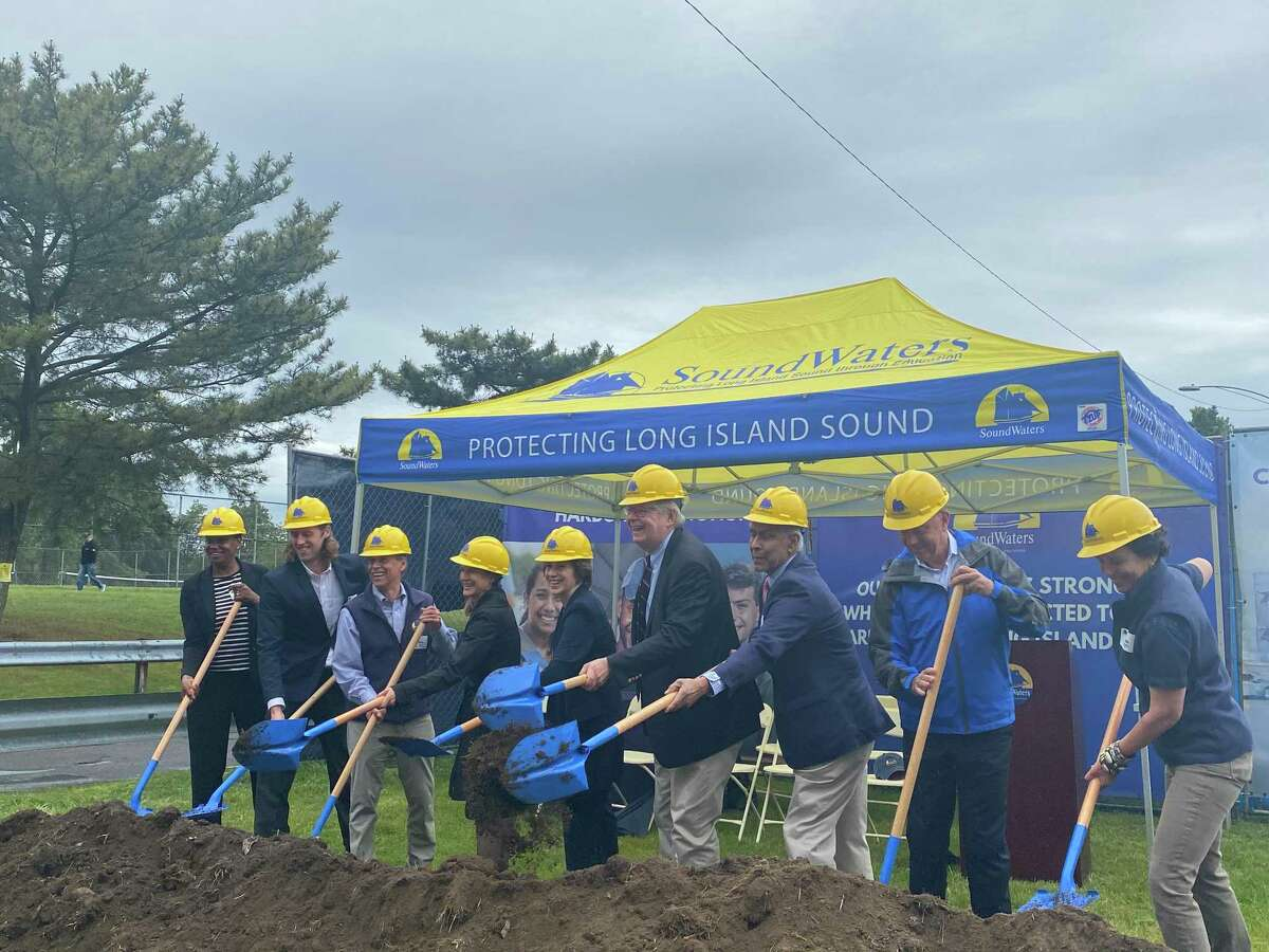 City and state officials - including Stamford Public Schools Superintendent Tamu Lucero, Mayor David Martin, Lt. Gov. Susan Biesywicz, and Gov. Ned Lamont - on Monday, June 14, 2021 shoveled the first piles of dirt for the Steve and Alexandra Cohen SoundWaters Harbor Education Center.