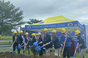 City and state officials — including Stamford Public Schools Superintendent Tamu Lucero, Mayor David Martin, Lt. Gov. Susan Biesywicz, and Gov. Ned Lamont — on Monday, June 14, 2021 shoveled the first piles of dirt for the Steve and Alexandra Cohen SoundWaters Harbor Education Center.