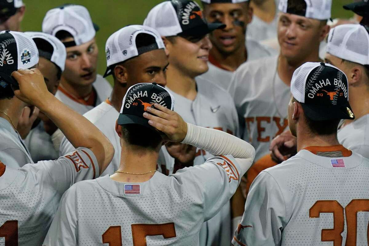Texas players wear 'Omaha Bound' caps as they celebrate their win over South Florida in an NCAA Super Regional college baseball game, Sunday, June 13, 2021, in Austin.
