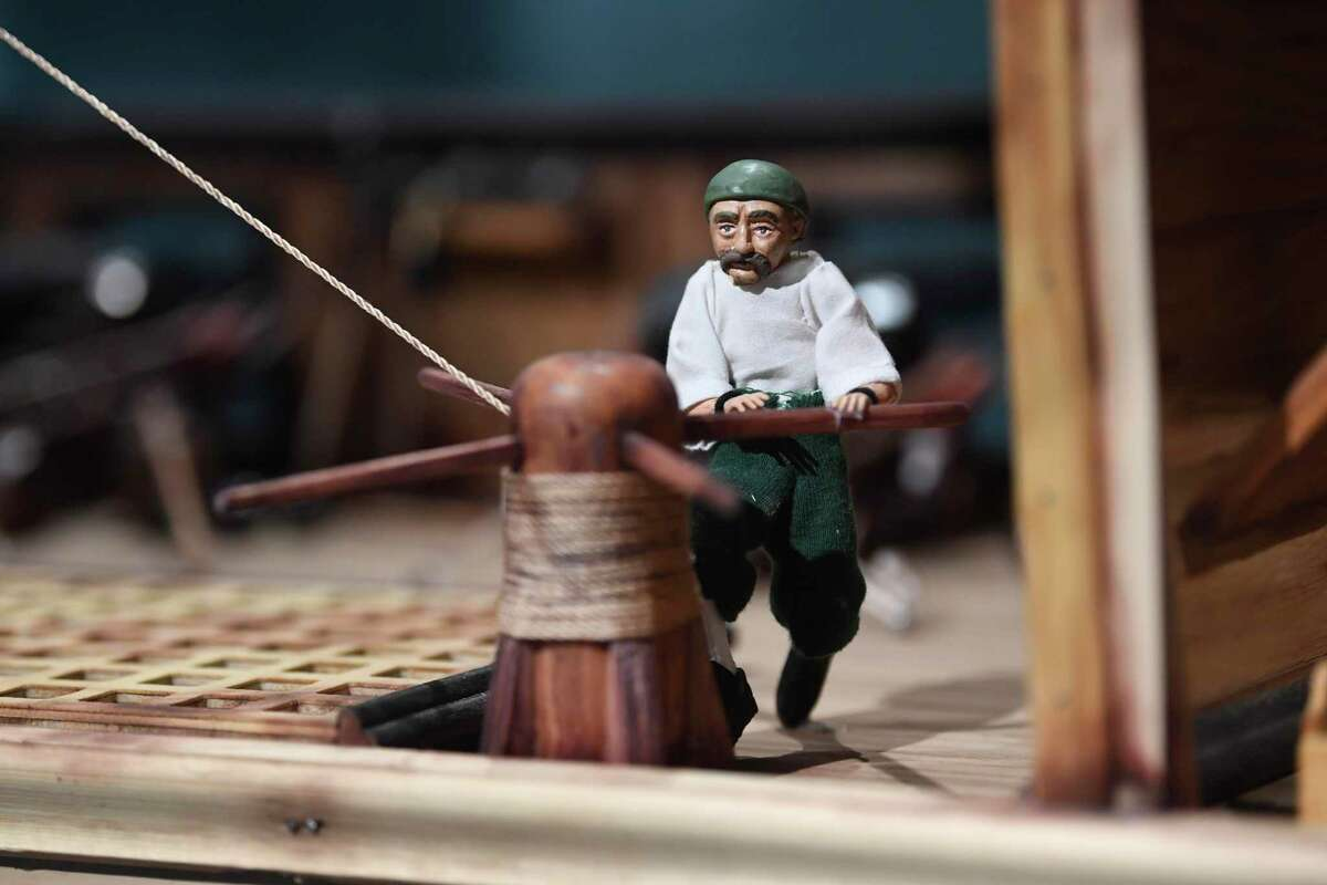 A Spanish galleon of the type that would have sailed between Acapulco, Mexico and Manila in the Philippines is on display in the New Spain art collection at the Bandera Natural History Museum on Thursday, June 10, 2021. This detail shows a sailor working the sail rigging.