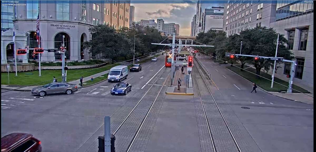 A screenshot from a traffic recording shows moments before a collision between an EMS vehicle and a Metrorail Houston train on Fannin Street and Cambridge Street.