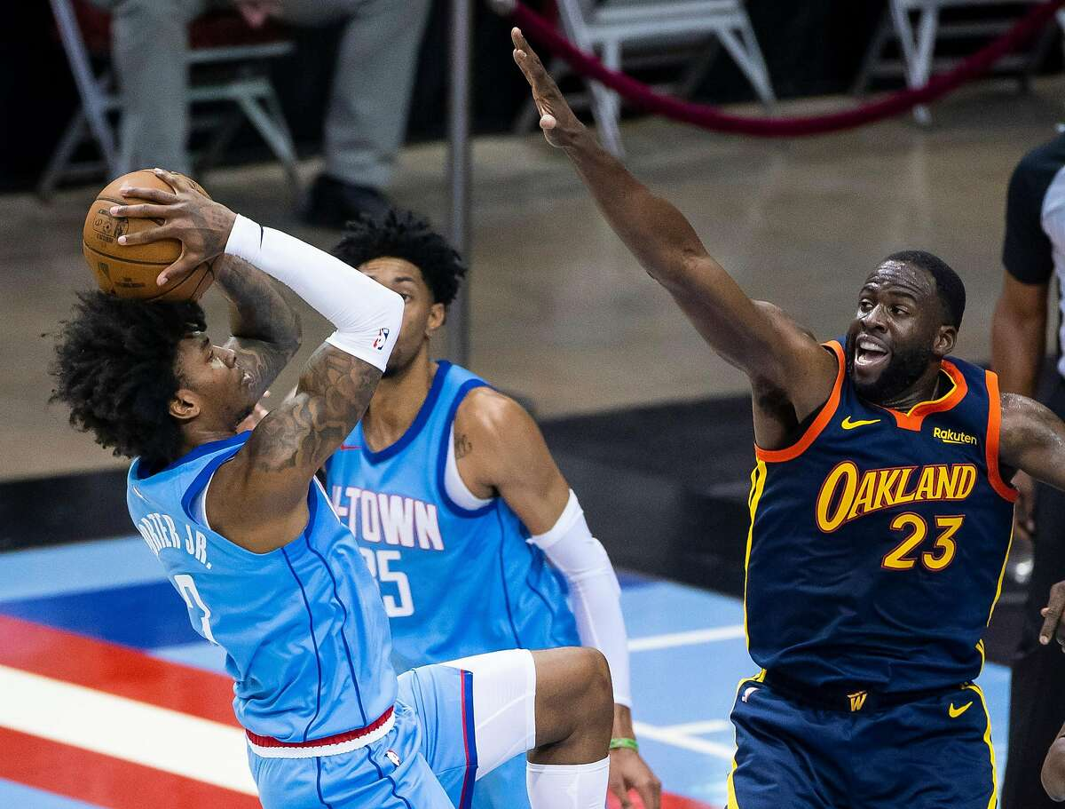 Houston Rockets guard Kevin Porter Jr. (3) shoots over Golden State Warriors forward Draymond Green (23) during the second quarter of an NBA game between the Houston Rockets and Golden State Warriors on Saturday, May 1, 2021, at Toyota Center in Houston.