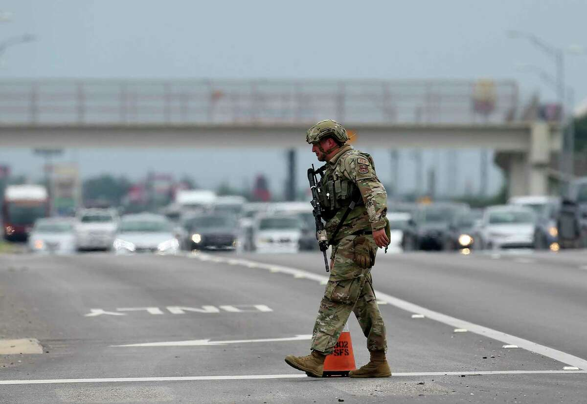 Soldiers guard the Gateway West Gate as Joint Base San Antonio-Lackland goes into full lockdown after an active shooter was reported Wednesday. San Antonio police found no evidence of gunfire, but the JBSA commander said Monday there were numerous and credible reports.