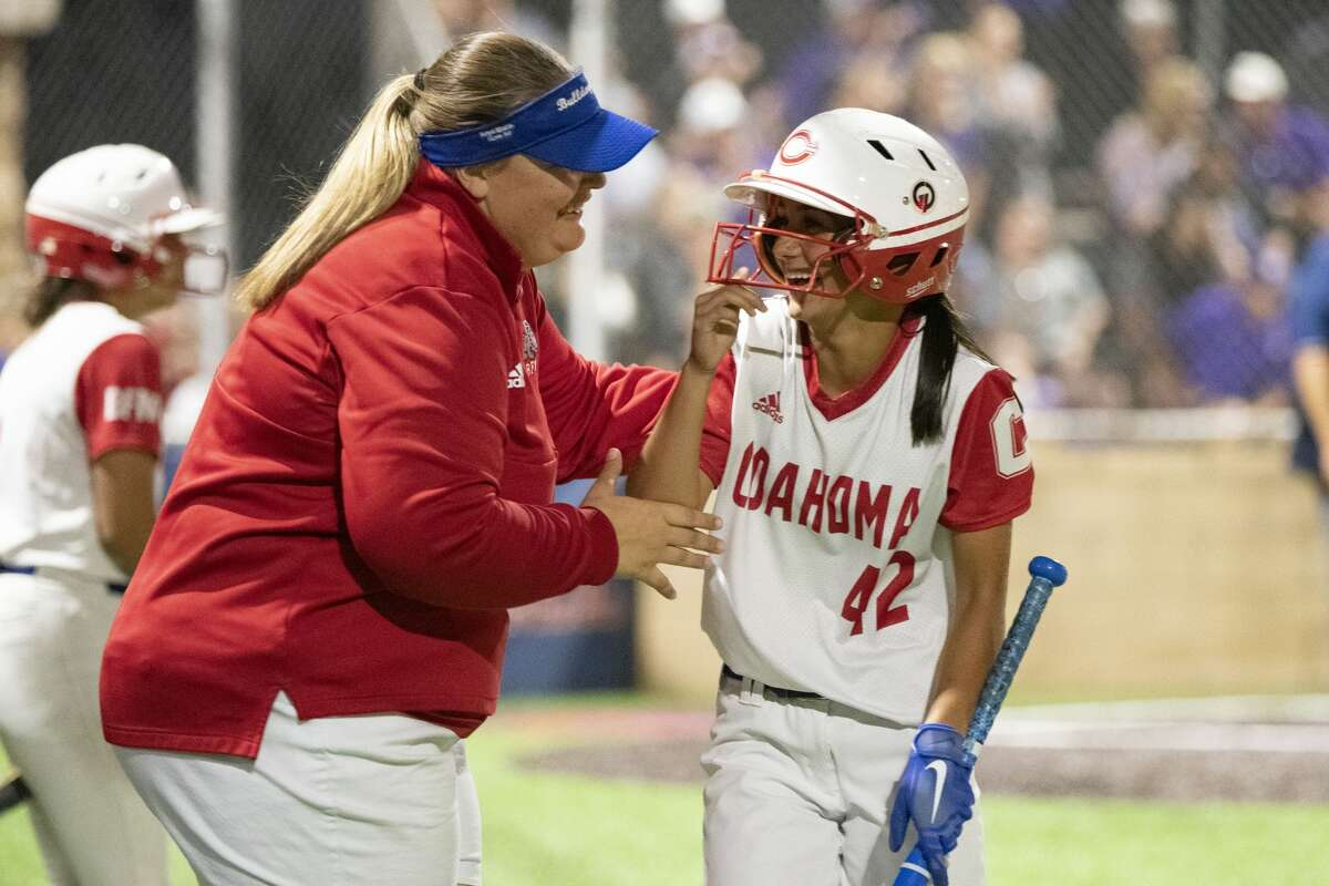 Coahoma assistant softball coach Katherine Shawver gives a few words of encouragement to a player during a playoff game against Jacksboro on May 14.