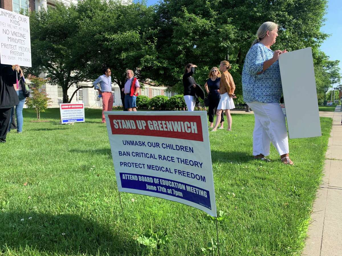 """A """"Stand Up Greenwich"""" sign at the June 14, 2021 """"Flag Day Rally"""" at Greenwich Town Hall, in Greenwich, Conn. The rally was organized by the Greenwich Patriots, who are protesting the masking and vaccination of students, as well as the alleged teaching of critical race theory."""