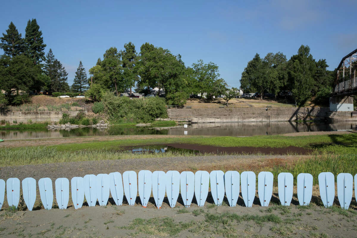The lack of flowing water on the Russian River at Memorial Bridge is viewed on June 3, 2021, near Healdsburg, Calif.