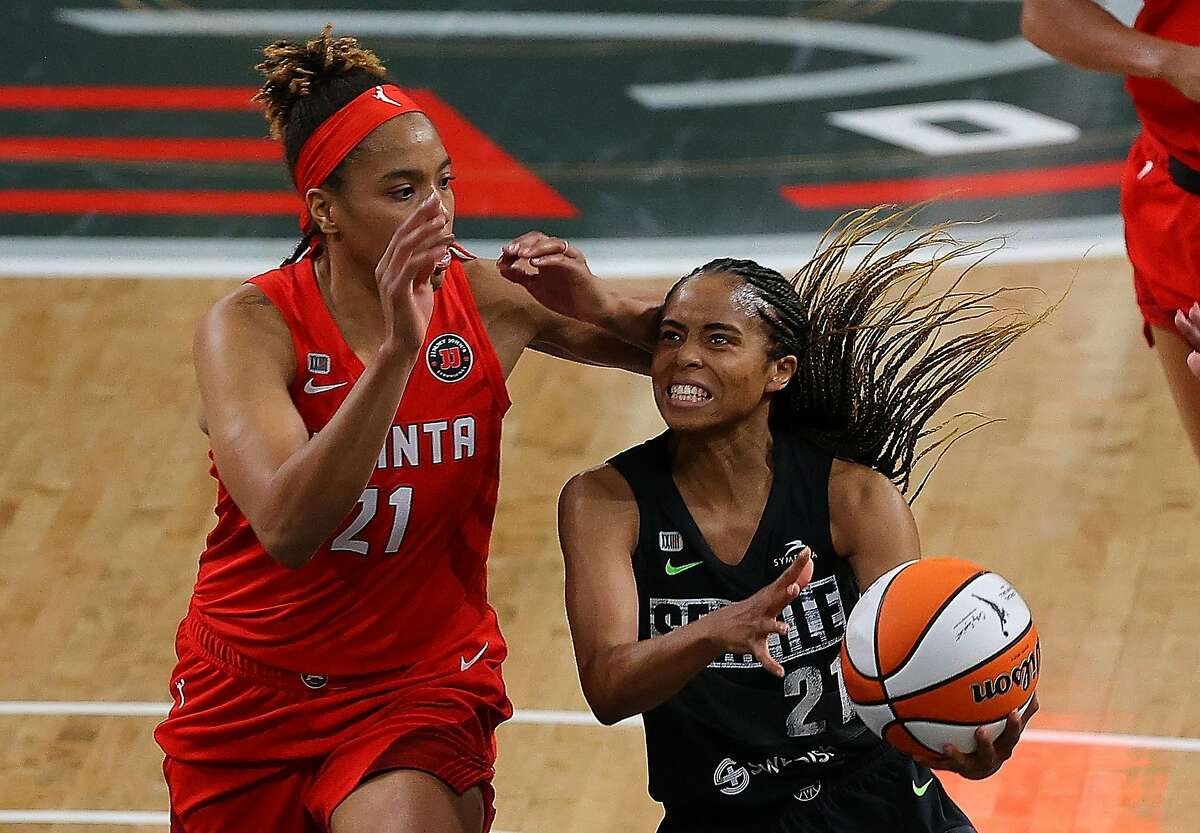 COLLEGE PARK, GEORGIA - JUNE 09: Jordin Canada #21 of the Seattle Storm drives against Tianna Hawkins #21 of the Atlanta Dream in the second half at Gateway Center Arena on June 09, 2021 in College Park, Georgia. (Photo by Kevin C. Cox/Getty Images)