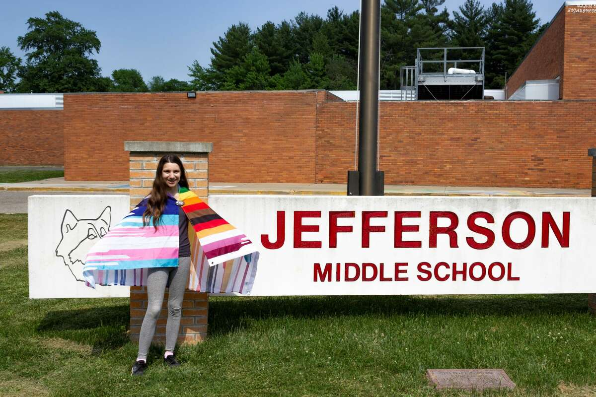Midland resdient Audra Segura, 13, stands next to the Jefferson Middle School sign.