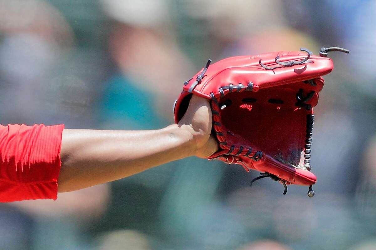 Jose Quintana (62) raises his glove to catch the ball from the catcher in the third inning as the Oakland Athletics played the Los Angeles Angels at the Coliseum in Oakland, Calif., on Sunday, May 30, 2021.