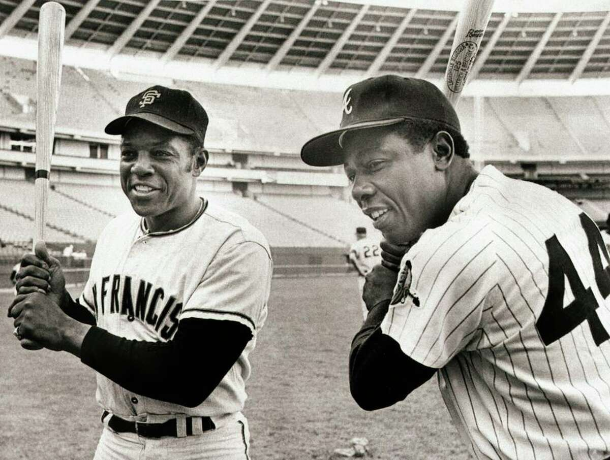 Recognized Negro League stats add 10 hits to Willie Mays' total, but he doesn't get closer to Hank Aaron (right) in HRs.