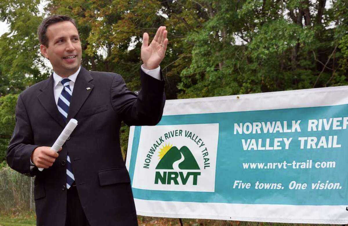 State Senator Bob Duff points to the bike trail that ends at Union Park in Norwalk during the Norwalk River Valley Trail Media Advisory held at the park on Monday, Sept. 13, 2010.
