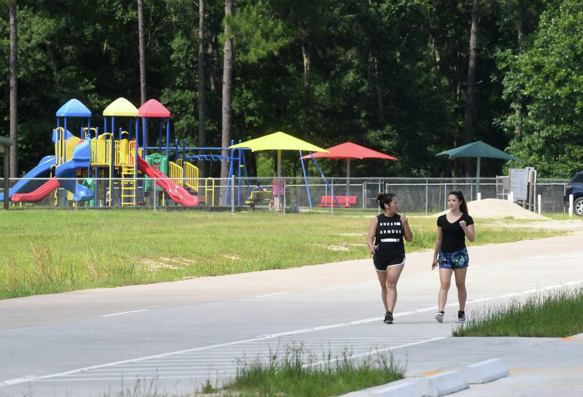 Victoria Ball, left, and Bailey Ball walk around the Lumberton City Park on Farm Road 421 Monday Afternoon. The city plans to purchase a large section of land north of the park for development. Photo taken Monday, 6/10/19