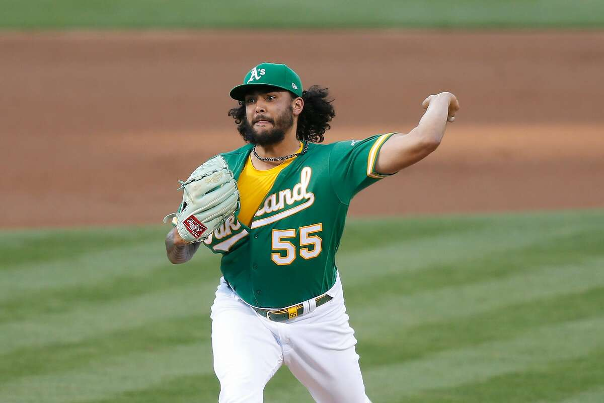 OAKLAND, CALIFORNIA - JUNE 14: Sean Manaea #55 of the Oakland Athletics pitches in the top of the second inning against the Los Angeles Angels at RingCentral Coliseum on June 14, 2021 in Oakland, California. (Photo by Lachlan Cunningham/Getty Images)