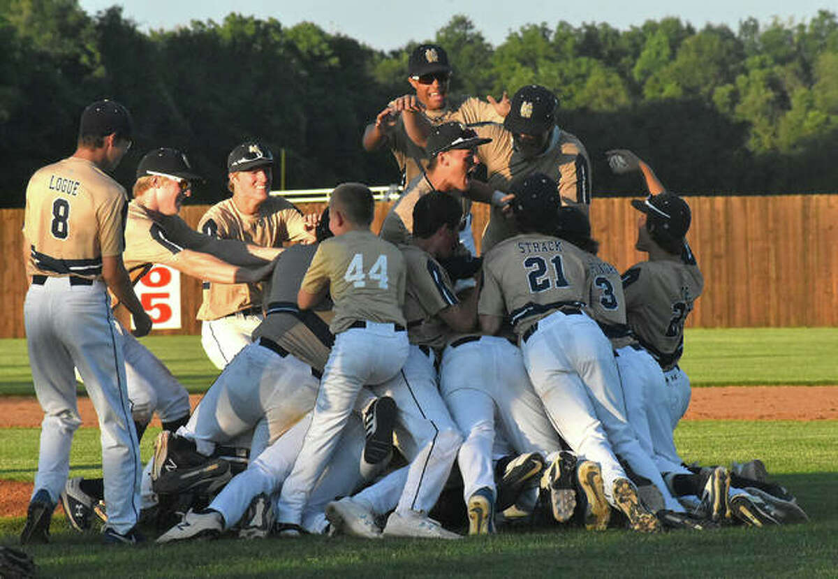 Father McGivney celebrates after its 4-0 win over Camp Point Central in the Class 1A Lincoln Land Community College Super-Sectional in Springfield.