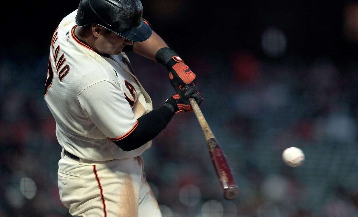 Donovan Solano (7) hits his second double of the game in the fifth inning as the San Francisco Giants played the Arizona Diamondbacks at Oracle Park in San Francisco, Calif., on Monday, June 14, 2021.